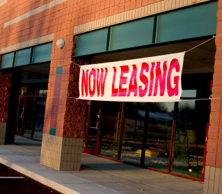 Now leasing banner on commercial space